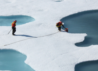 NASA scientist take Arctic sea ice water samples