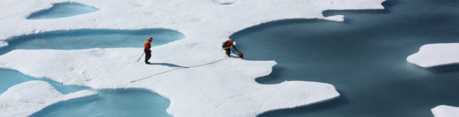 scientists uplift canister from sea ice