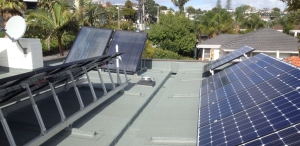 Photovoltaic and Solar Water Heating panels on roof