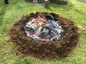 The Charcoal Fire nearing the time to extinguish it to create the biochar.